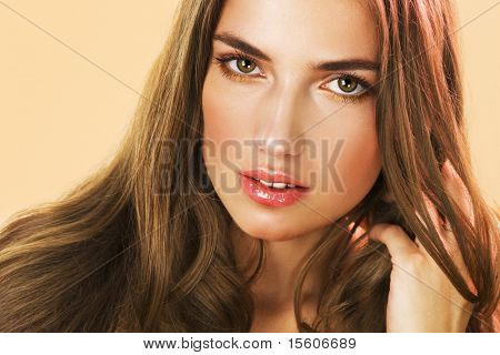 Beauty with long hair and golden makeup