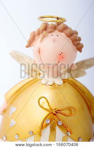 Smiling angel figurine closeup christmas or valentine background