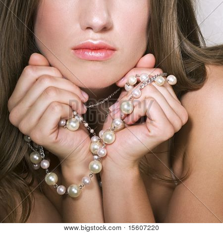 Woman with pearl jewelry