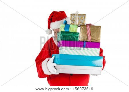 Santa claus hiding behind the gifts against white background