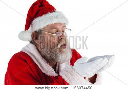 Santa claus in eyeglasses blowing invisible snow against white background