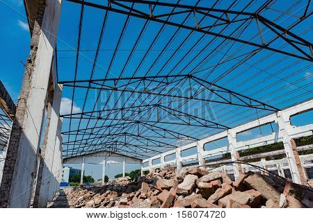 Demolition of an old factory building with steel roof