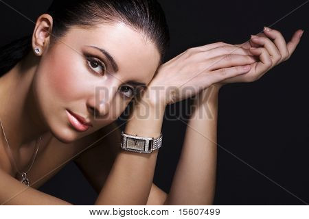 Woman with silver wristwatch