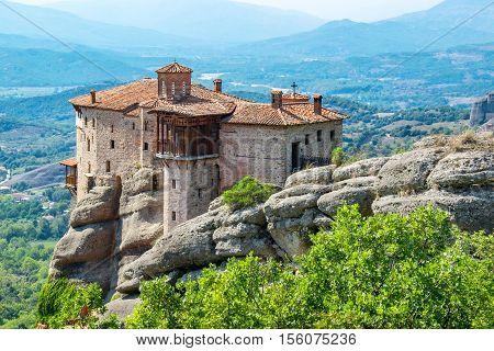 View of the Meteora with Monastery of Roussanou (Agias Varvaras). Meteora Thessaly Greece Europe
