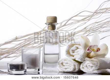 Spa still life with bottle of herbal essenses.