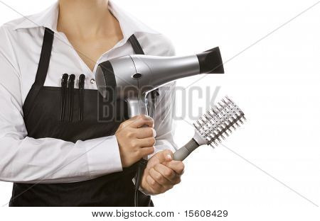 Hairdresser in uniform with working tools. Space for text.