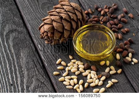 Nuts (seeds) cone oil of Siberian pine (Pinus sibirica). It is used in dietary and healthy nutrition cosmetics skin care. The source of vitamins and polyunsaturated fatty acids