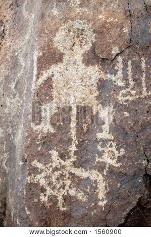 Spiral, Human Figure, Circle And Shield Petroglyph