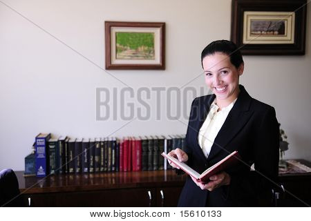 portrait of a female lawyer at office Remark for editors: Pictures on the wall were changed on Photoshop (no property release necessary)