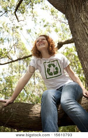happy volunteer with recycling t-shirt in the forest