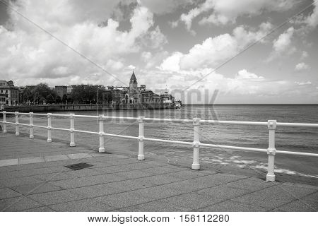 Photo in black and white of a church with white railing