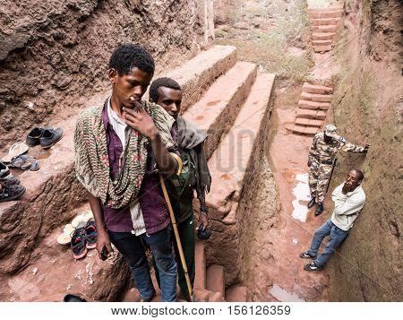 LALIBELA ETHIOPIA - JUNE 26 2016: Local people visitig the complex of rock-hewn churches in Lalibela Ethiopia.
