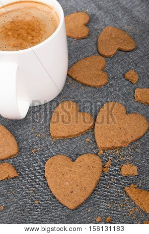 Cup of coffee and heart shaped cookies. Selective focus.