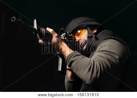 Policeman of the special unit. A man with a gun wearing a bulletproof vest and helmet