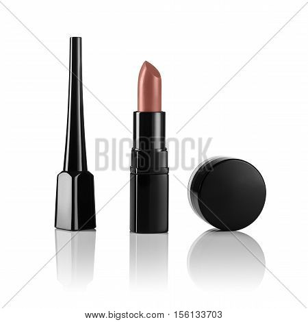 Nude or beige lipstick on white, reflective, mirror background. Concept for cosmetic or beauty advertising with ample copyspace.