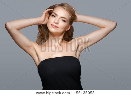 Woman Beauty. Blond Woman With Healthy Skin. Gray Background. Studio Shot.