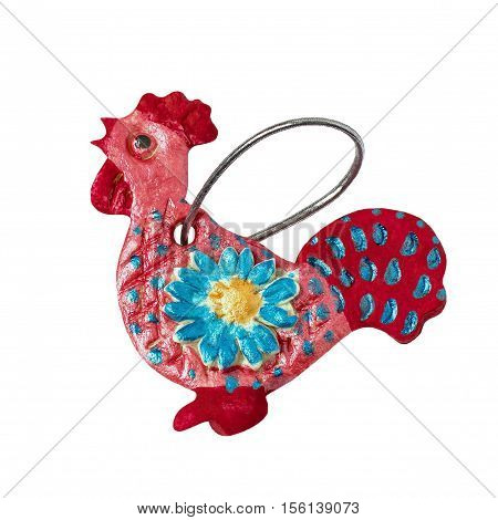 Homemade for Christmas decoration made child of salt dough isolated on white background. Rooster - symbol of the new year 2017 on the eastern calendar. Children's art project. DIY concept