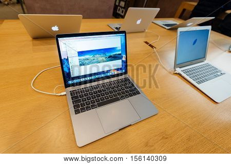 PARIS FRANCE - NOV 10 2016: New latest MacBook Pro Retina with on wooden table. The fourth generation MacBook Pro was revealed on October 27 2016. Phil Schiller described it as the