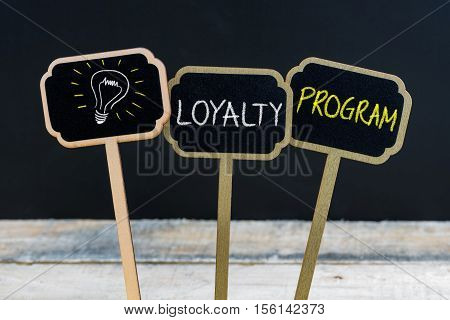 Concept Message Loyalty Program And Light Bulb As Symbol For Idea