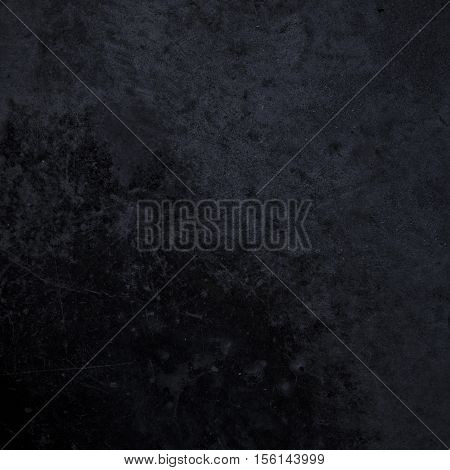 Rough textured black grunge dark concrete photo background