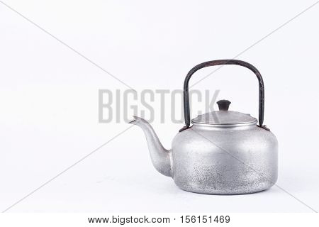 old vintage retro Kettle on white background drink isolated ( still life). Which, kettle made of aluminum materials.