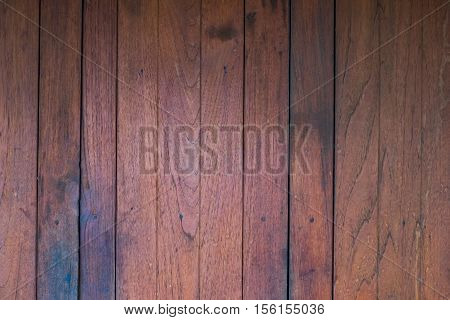 Planks of wood damaged by the aging process.