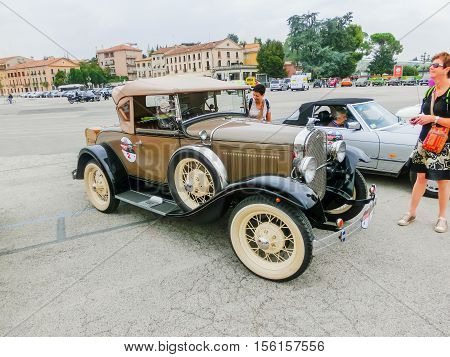 Padua Italy - September 19 2014: Benefit Antique Classic Car Show: People visiting Benefit Antique Classic Car Show at Padua at September 19 2014. Cars and enthusiasts from all over Italy.