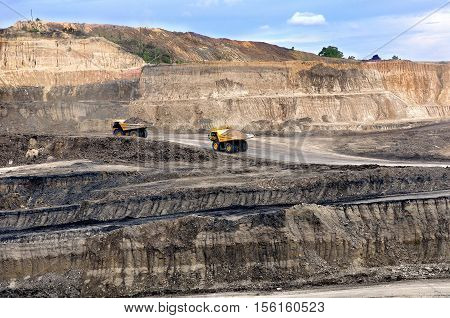 Two big truck on open pit hauling marerial overburden on open pit