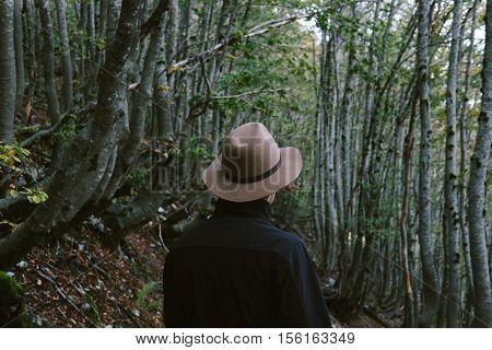 Man Wearing Hat Gloves Looking Away. Travel Cocept