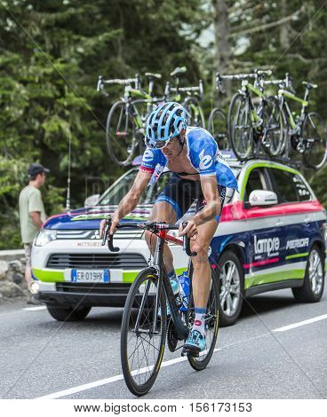 Col du Tourmalet France - July 242014: The Belgian cyclist Johan Vansummeren of Garmin-Sharp Team climbing the difficult road to Col du Tourmalet in Pyrenees Mountains during the stage 18 of Le Tour de France 2014.