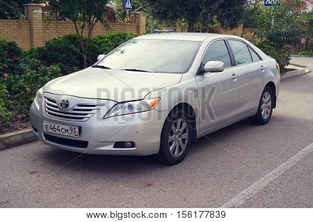 Sochi, Russia - October 11, 2016: Toyota Camry parked on the street of Sochi City suburb.