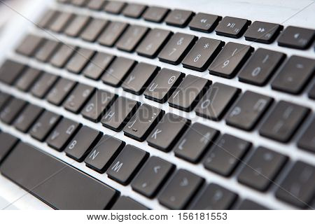 Laptop keyboard. Closeup view from the right size.