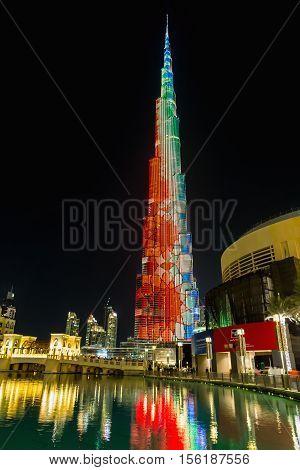 DUBAI UAE - NOVEMBER 8 2016: Burj Khalifa skyscraper is tallest in the world. Color projection on a building skyscraper