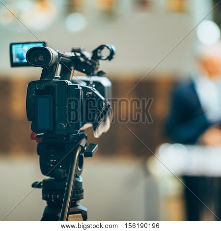 Television camera on Press Conference, toned image, horizontal