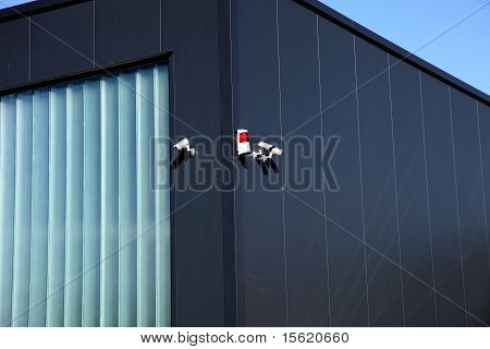 Surveillance Camera And Alarm System On A Building-vertical