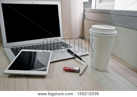 Office Supplies With Coffee Cup And Laptop In The Office