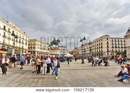 MADRID, SPAIN - OCTOBER 26, 2015: Puerta del Sol square in the center of Madrid. Puerta del Sol - 0 kilometer radial network of Spanish roads, from here take readout whole network of Spanish roads