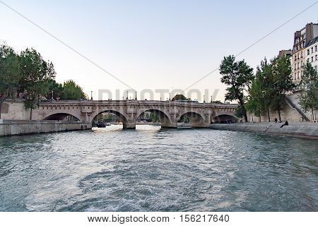 architecture, boat, bridge, building, cite, city, dusk, embankment, europe, european, evening, famous, france, french, historical, history, house, island, landmark, monument, neuf, new, night, old, outdoor, paris, pont, quay, river, seine, stone, street,
