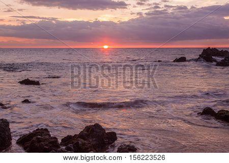 a beautiful sunset along g the Maui Hawaii coast