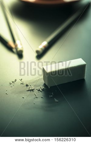 Mistake Concept, Rubber Eraser On Black Table Erase Mistake Background.