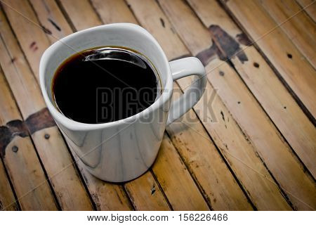Cup Of Coffee On Bamboo Table In Morning Sunlight