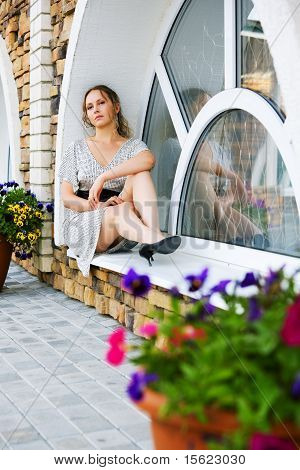 Woman Sitting On The Window