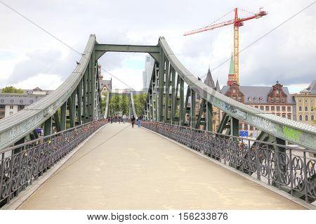 FRANKFURT AM MAIN GERMANY - May 07.2014: Pedestrian bridge over the river Main
