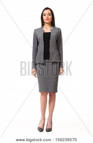 woman with straight hair style in blue official gray skirt and jacket power suit high heels shoes full length body portrait standing isolated on white