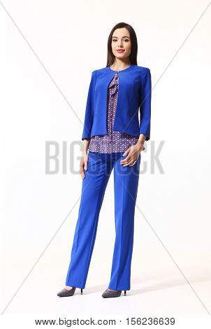 woman with straight hair style in blue official suit trousers and jacket high heels shoes full length body portrait standing isolated on white