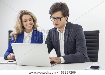 Woman In Blue Blazer And A Guy Wearing Glasses Are At Their Workplace