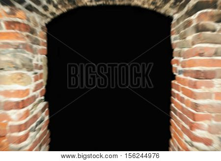 Blurry old brick gothic arc entrance into darkness can be used as frame for your text