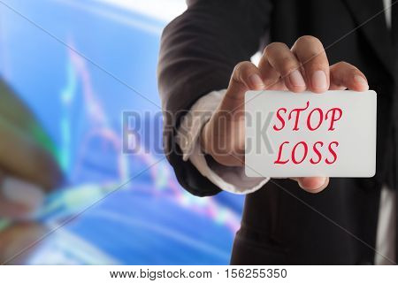 Businessman showing business card with stop loss text concept of diversification in investing.