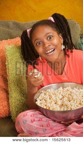 Overjoyed Little Girl With Popcorn