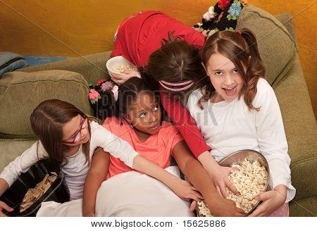 Little Girls Grab Popcorn